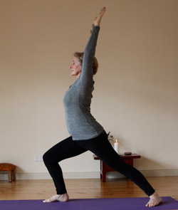 Janet Coutts practices Yoga in the main Yoga space at Norwood Yoga House